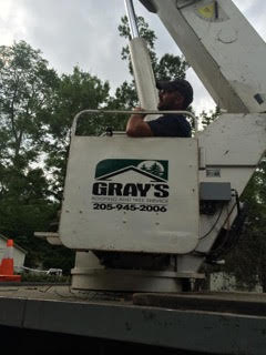 grays roofing man in crane